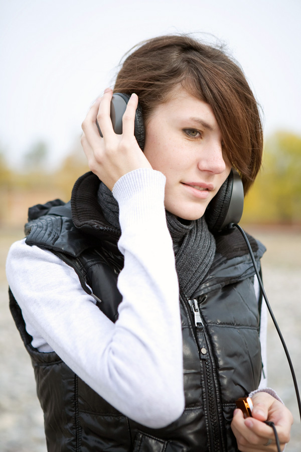 young person listening to headphones